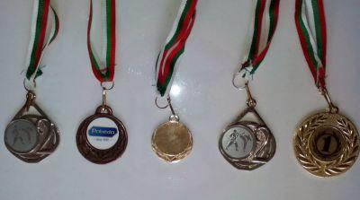 Таня Петрова Гуторанова 3г клас с медали от състезания по таекуондо - Изображение 2